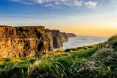 pic of cliffs moher  - Cliffs of Moher in western Ireland with a low sun  - JPG