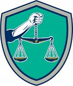 image of scale  - Illustration of a hand holding weighing scale scales of justice viewed from front set inside shield crest on isolated background done in retro style - JPG