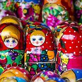 stock photo of doll  - Colorful Russian nesting dolls matreshka at the market - JPG