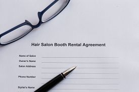 image of rental agreement  - hair salon booth rental agreement on the white paper with pen - JPG