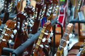 pic of bluegrass  - rows of the guitars at music store - JPG