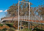 Suspension Footbridge Across An Australian Outback River