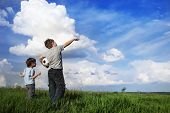 Постер, плакат: boy showing something to his friend in the clouds incredible miracle