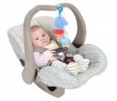 image of youg  - Baby in child car seat isolated over white background - JPG