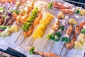 Homemade Skewer With Delicious Grilled Shrimps On Parchment Paper poster