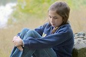 stock photo of 13 year old  - 13 year old girl deep in thought - JPG