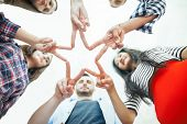 Five Young Smiling People Make Star Shape From Fingers poster