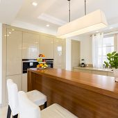 Functional Cooking Area With Wooden Furniture poster