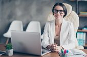 Portrait Of Confident Smart Successful Beautiful Businesswoman Wearing White Jacket, She Is Sitting poster