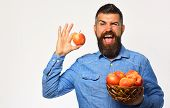 Man With Beard Holds Wicker Bowl With Apple Fruits poster