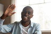 Head Shot Cheerful African Guy Look At Camera Wave Hand poster