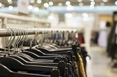 Modern Show Room Selling Clothes Men, Women Children. Hangers Bright Fashionable Clothes. Hoodies, S poster