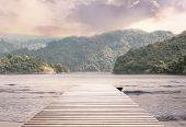 Wood Bridge On The Sea Which Has Walk Way For Travel Tourism With Tropical Forest Island And Sunshin poster
