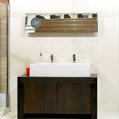 picture of lavabo  - Big double faucet sink over wooden locker - JPG