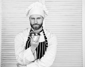 Man Cook Hat And Apron Hold Meal Covered With Lid. Delicious Meal Presentation. Haute Cuisine Charac poster