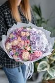 Beautiful Bouquet Of Mixed Flowers In Woman Hand. Floral Shop Concept . Handsome Fresh Bouquet. Flow poster