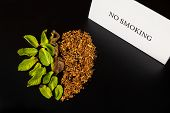 Heart Made From Green Plant/mint And Tobacco Is On The Black Table/background. There Are Note no Sm poster