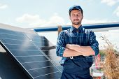 Young successful master of solar panel installation poster