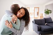 Loving Couple Hugging Holding Keys To New Home On Moving Day poster
