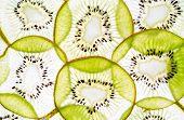 Top View Of Sliced Kiwi As Background. Fresh Cut Sliced Green Kiwifruit Kiwi Fruits On Brown Grey Bo poster