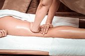 Relaxing Leg Massage With Oil For Massage Salon Client. poster