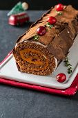 Buche De Noel. Traditional Christmas Dessert, Christmas Yule Log Cake With Chocolate Cream, Cranberr poster