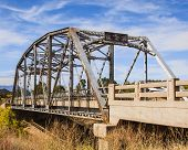 stock photo of winona  - A closed and abandoned bridge in a field on the former path of Rt 66 near Winona AZ - JPG
