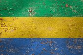 National Flag Of Gabon On Old Peeling Wall Background.the Concept Of National Pride And Symbol Of Th poster