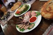 foto of collate  - The slices of meat as cold collation at a pub - JPG