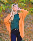 Clothing For Every Day. Girl Adorable Blonde Posing In Warm And Cozy Outfit Autumn Nature Background poster
