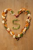 stock photo of satsuma  - Fresh sliced fruit in a heart shape with plums - JPG