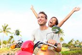 pic of excite  - Happy free freedom couple driving scooter excited on summer holidays vacation - JPG