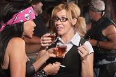 picture of peer-pressure  - Blond woman and biker gang lady talking while smoking and drinking - JPG