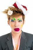 picture of freaky  - Freaky asian boy with flower in mouth - JPG