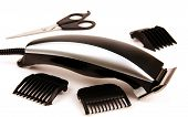 stock photo of electric trimmer  - electric clippers scissors hairdressing tips photo on light background - JPG