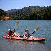 image of middle-age  - A middle age couple kayaking on the lake - JPG