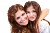 Portrait of mother with teenage daughter isolated on white background, best friends, hugging each ot