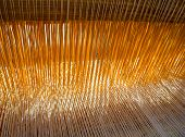 The threads in the old weaving loom