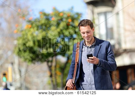 Young urban professional man using smart phone. Businessman holding mobile smartphone using app text poster
