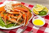 picture of cooked crab  - Snow Crab legs with fresh lemon slices and butter sauce - JPG