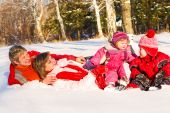 stock photo of family fun  - Happy family playing together in winter park - JPG