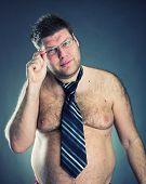 stock photo of pervert  - Serious shirtless man - JPG
