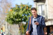 picture of sms  - Young urban professional man using smart phone - JPG