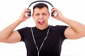 pic of yell  - angry man yelling and shouting listening to loud music with headphones - JPG