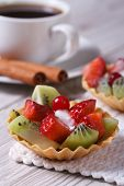 Tartlets With Strawberries And Kiwi With A Cup Of Coffee