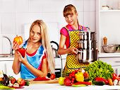 foto of pinafore  - Mother and daughter cooking food at kitchen - JPG