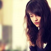 foto of depressed teen  - Young teen woman with depression - JPG