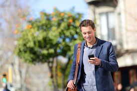 image of jacket  - Young urban professional man using smart phone - JPG