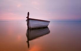 image of sloop  - Lonely boat on the lake - JPG