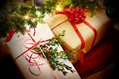 stock photo of bowing  - Christmas gifts with ribbons and bows under the tree - JPG